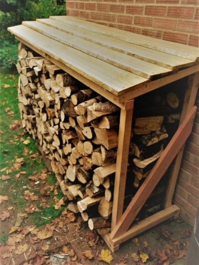 Custom built log store from Forest to Fire, West Dean Chichester, West Sussex
